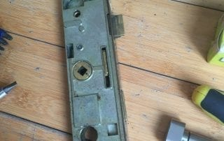 Oakwood Locksmith Showing uPVC door mechanism repair